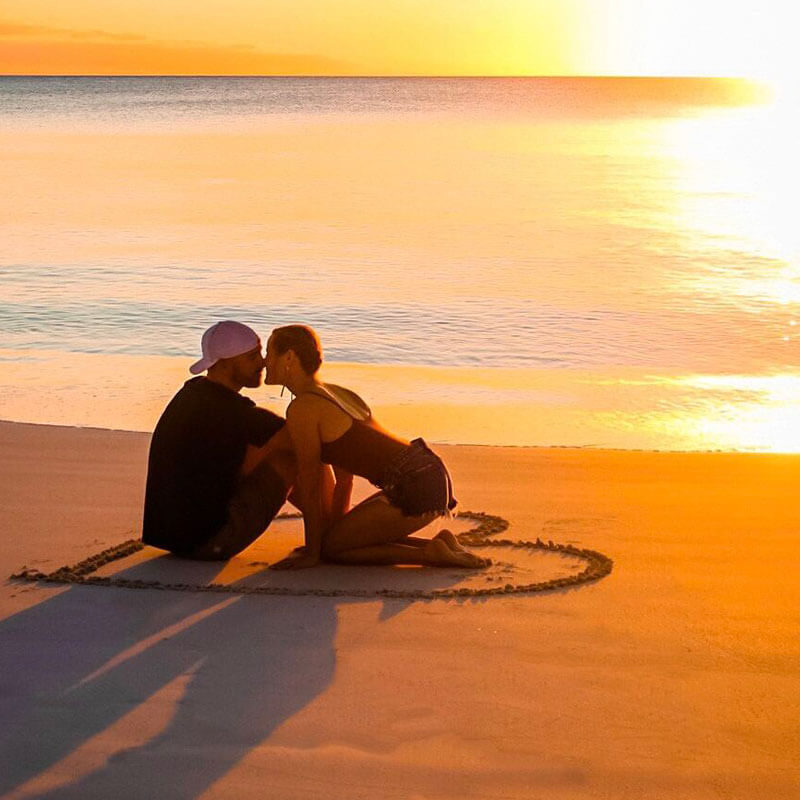 Couple on beach during sunset